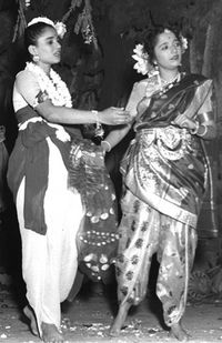 Two Indian women in a scene from a play about Shakuntala