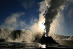 Steam Phase eruption of Castle geyser with shadows.jpg